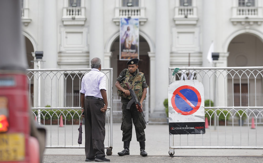 A Sri Lankan army soldier stands guard at the entrance to a closed Catholic church in Colombo, Sri Lanka, Friday, May 3, 2019.