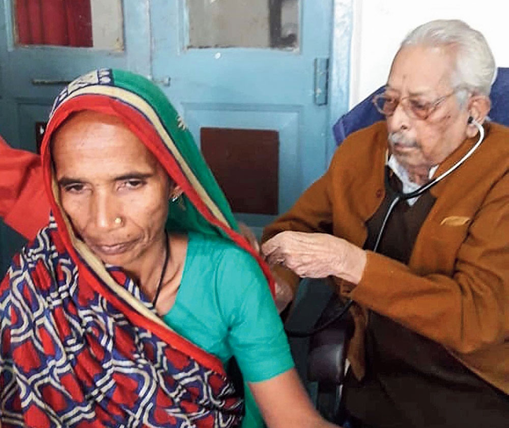Retirement, what's that? Dr Birendra Prasad examines a patient in Araria.
