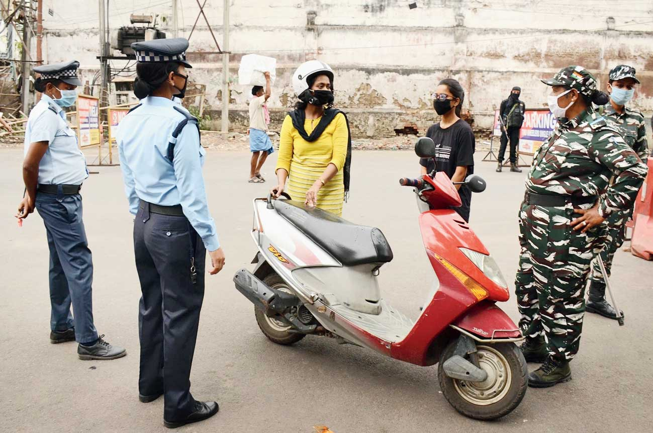 Traffic police stop a two-wheeler rider in Guwahati on Saturday.