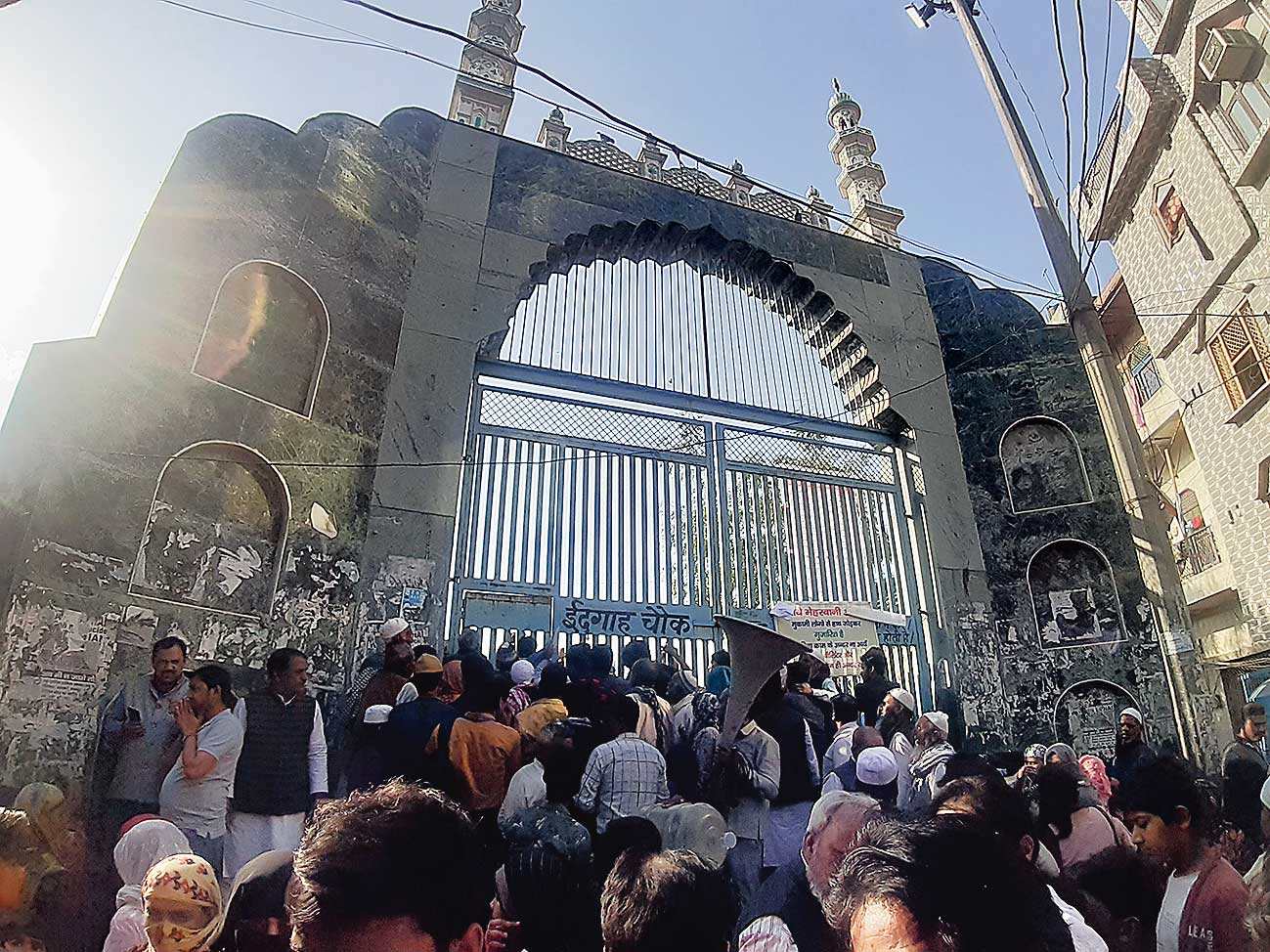 The throng at the entrance of the Mustafabad idgah.