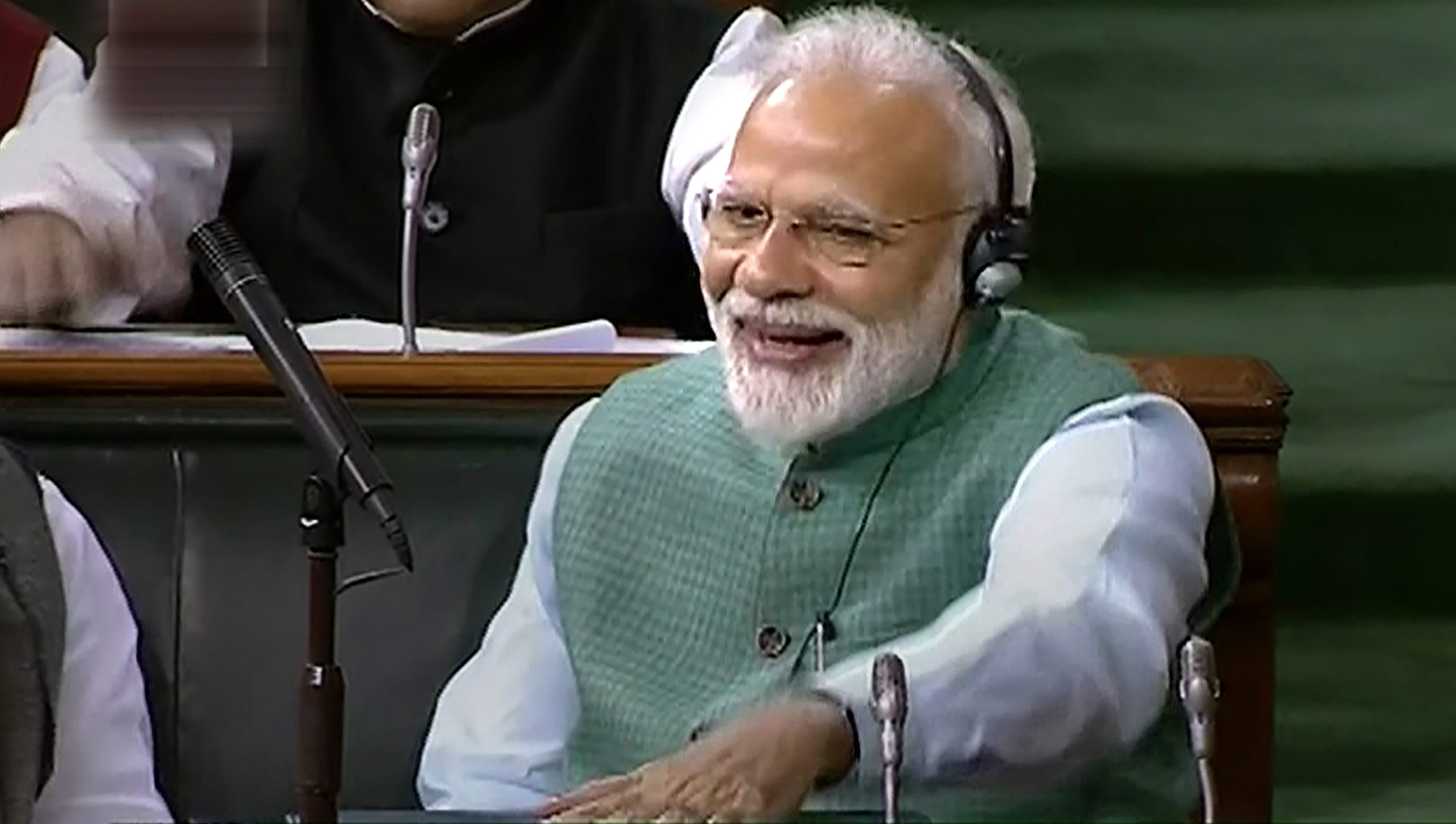 Prime Minister Narendra Modi cheers as Finance Minister Piyush Goyal presents the interim Budget on Friday