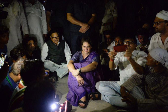 Priyanka Gandhi Vadra during the dharna at Chunar Fort Guest House in Mirzapur on July 19, 2019. Unlike some of her senior colleagues who relish the role of arm-chair activism, she chose to take the battle to the BJP