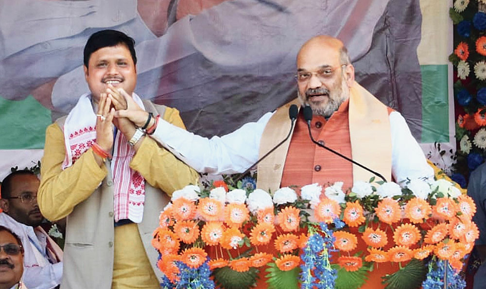 BJP national president Amit Shah with Moni Madhab Mahanta, the BJP-AGP-BPF alliance candidate for Kaliabor Lok Sabha seat, during the rally on Thursday