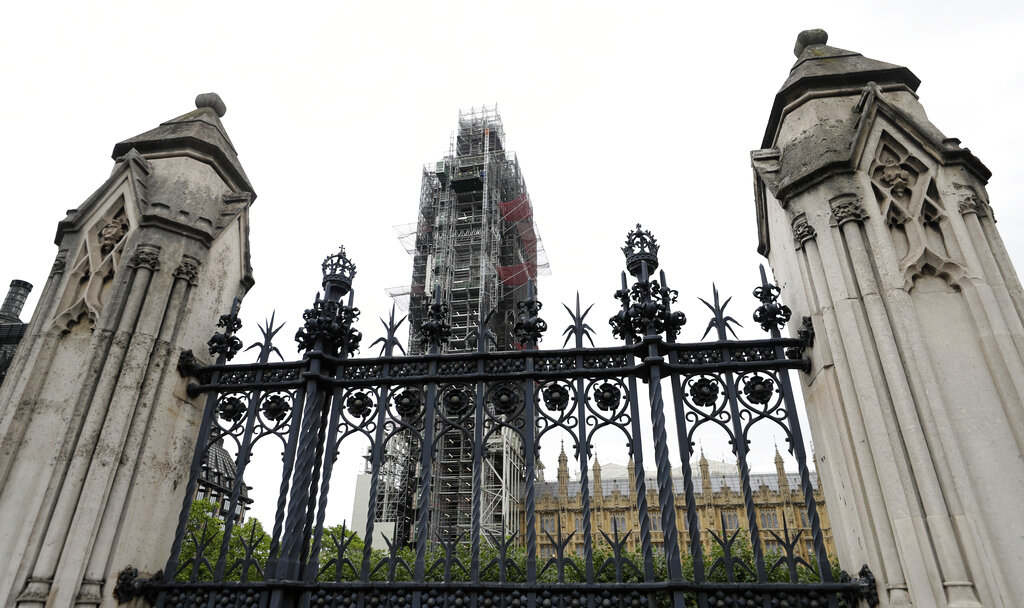 Britain's Parliament buildings are seen behind the high fences in London, on Monday
