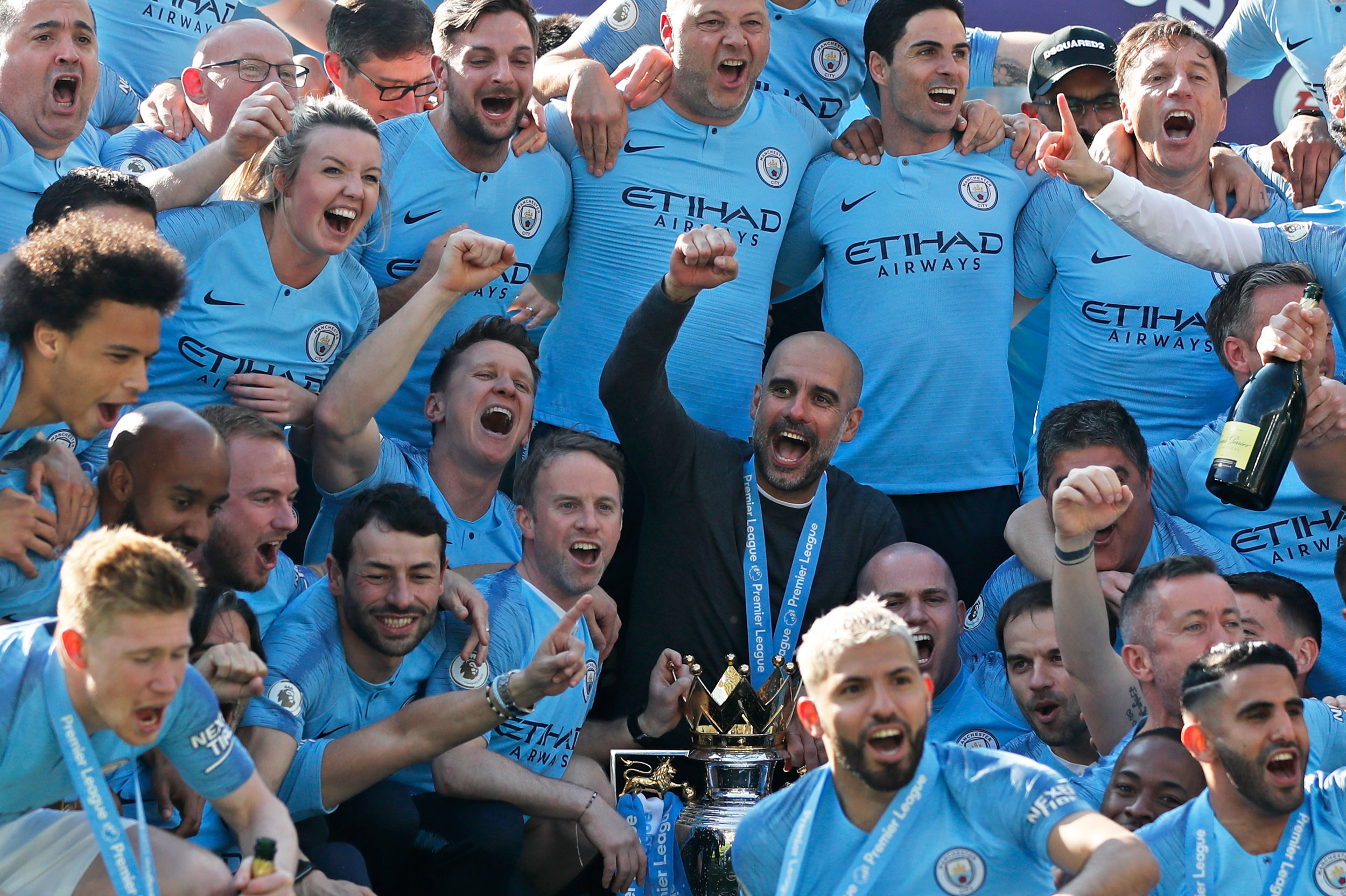 Manchester City players and support staff with the Premier League trophy in Brighton on Sunday.