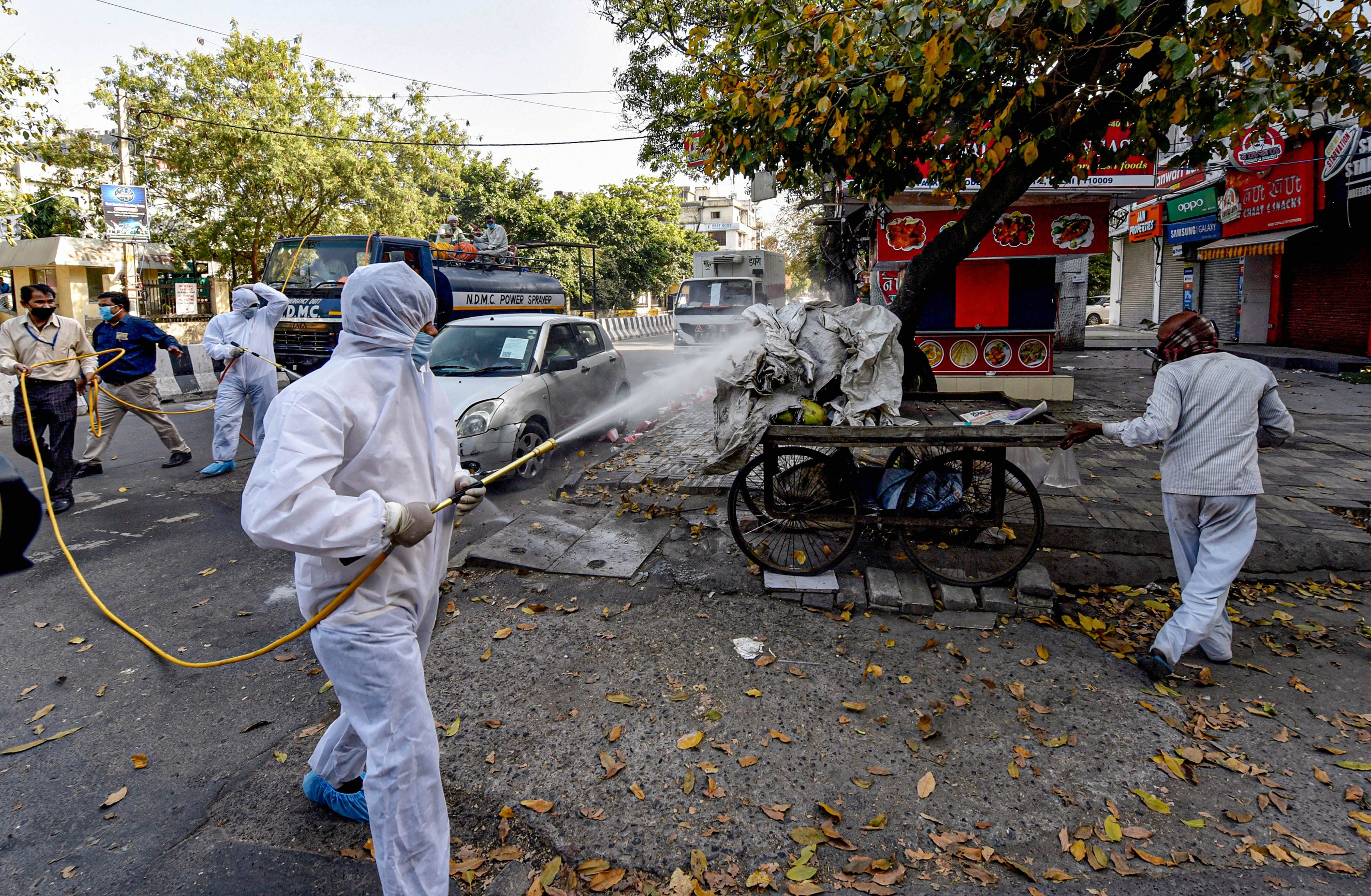 North MCD workers sanitise a locality in Model Town in view of coronavirus outbreak, during the ongoing nationwide lockdown, in New Delhi, Monday, April 6, 2020.