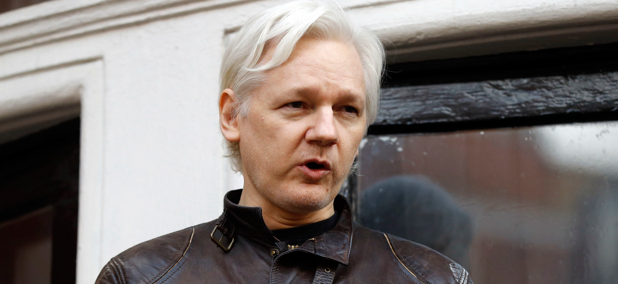 In this May 19, 2017, file photo, WikiLeaks founder Julian Assange gestures to supporters outside the Ecuadorian embassy in London, where he lived in self imposed exile from 2012 until his arrest on April 11, 2019.