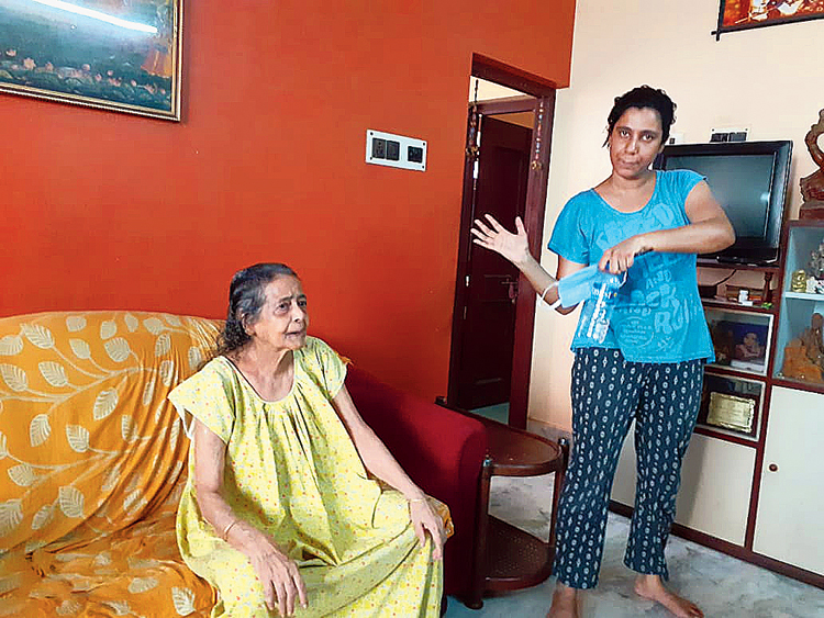 Rita Goswami (left) with her granddaughter Vijaylakshmi Dubey. The wires landed on the Dubeys' verandah. Vijaylakshmi and her sister Anushka had to bodily lift their grandmother, Rita Goswami, 81, and shift her to a relative's home close by as they feared that their house would be electrified because of the invading wires