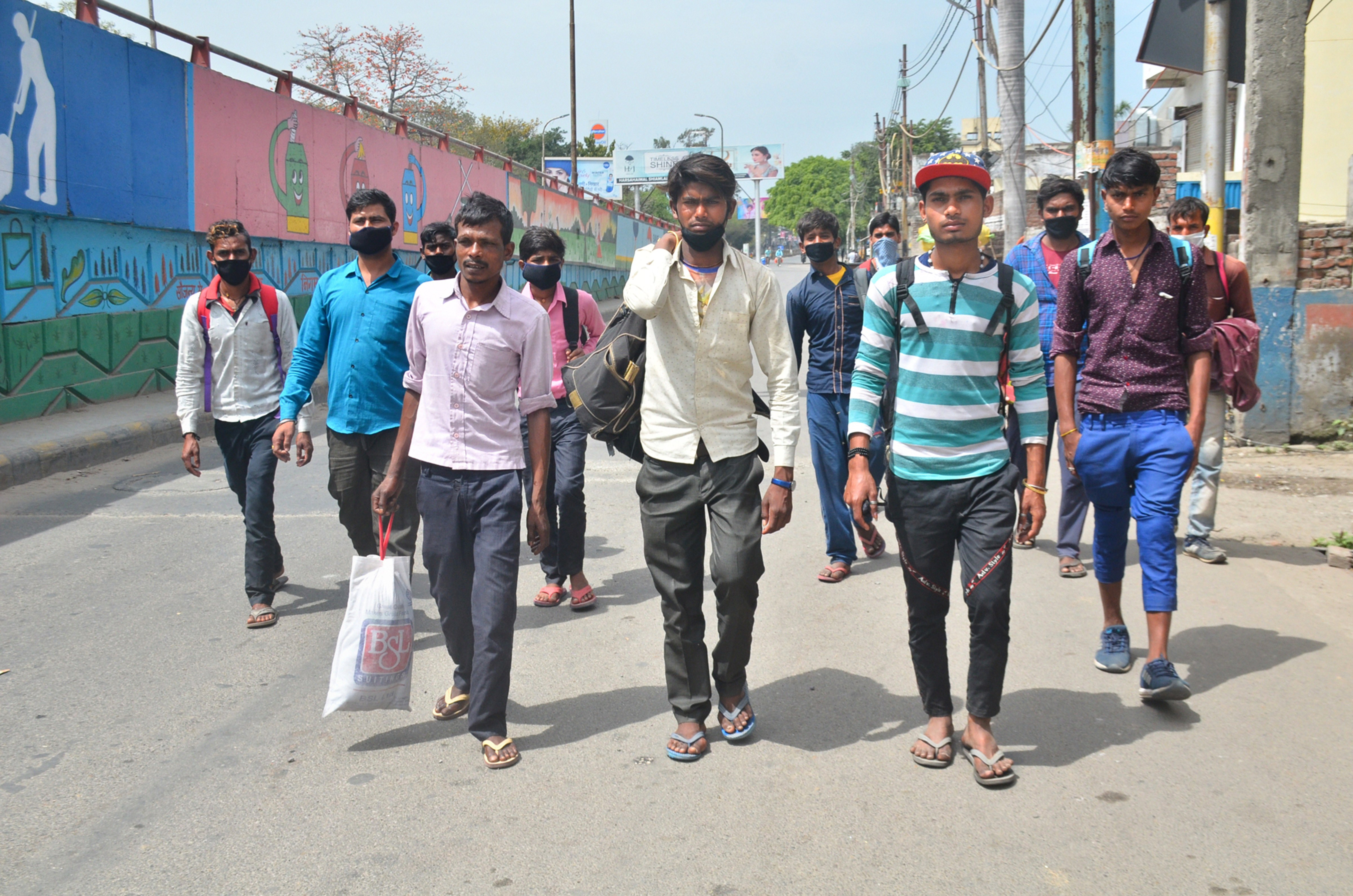 Migrant workers walk towards their home in Bareilly in the absence of any means of transportation, during day-2 of a nationwide lockdown imposed in the wake of coronavirus pandemic, in Moradabad, Thursday, March 26, 2020