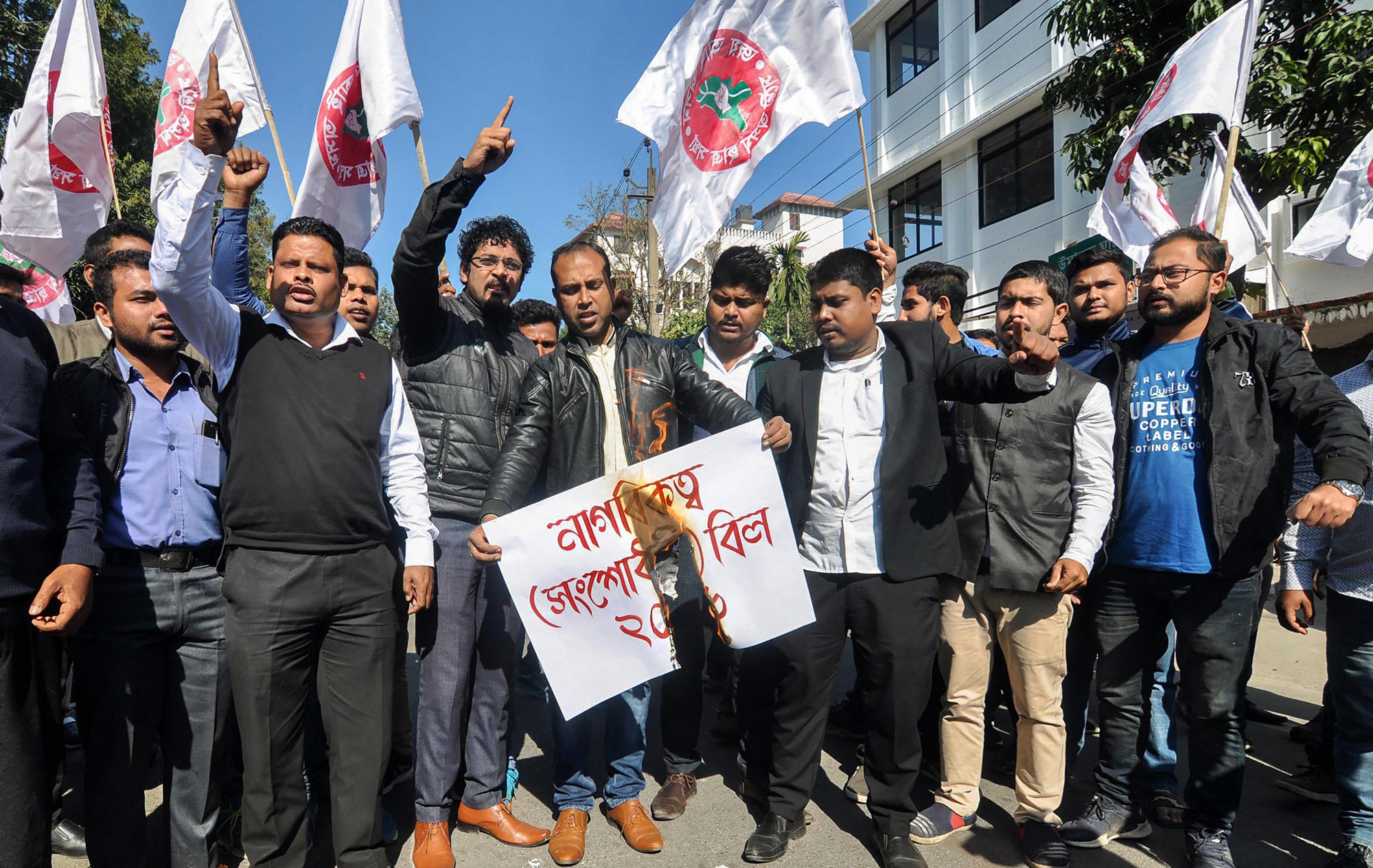 All Assam Students Union (AASU) activists hold placards as they raise slogans protesting against Citizenship (Amendment) Bill, 2016, in Guwahati on Monday, January 7, 2019.