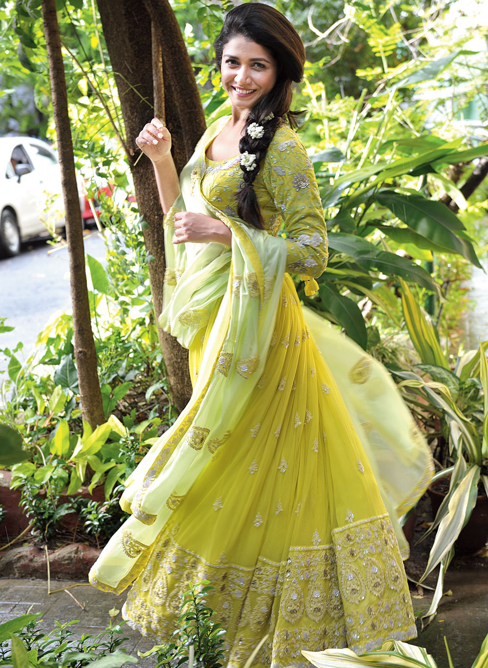 """This lime green lehenga with hand-embroidery and sequin detailing lends a soft look. """"This lehnga is flowy and we have kept the embroidery minimal with the choli and the border of the skirt intricately designed,"""" say Garo designer duo, Sweta Tantia and Priyangsu Maji"""