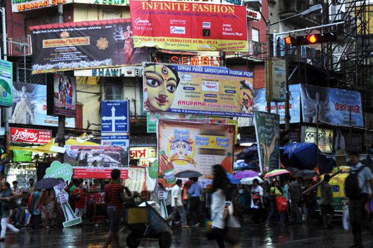 In Calcutta, during the Durga Puja season, the banners, flexes and billboards stuffed into every available space on, above and beside roads and pavements are blinding, dangerous, hideous and stifling.