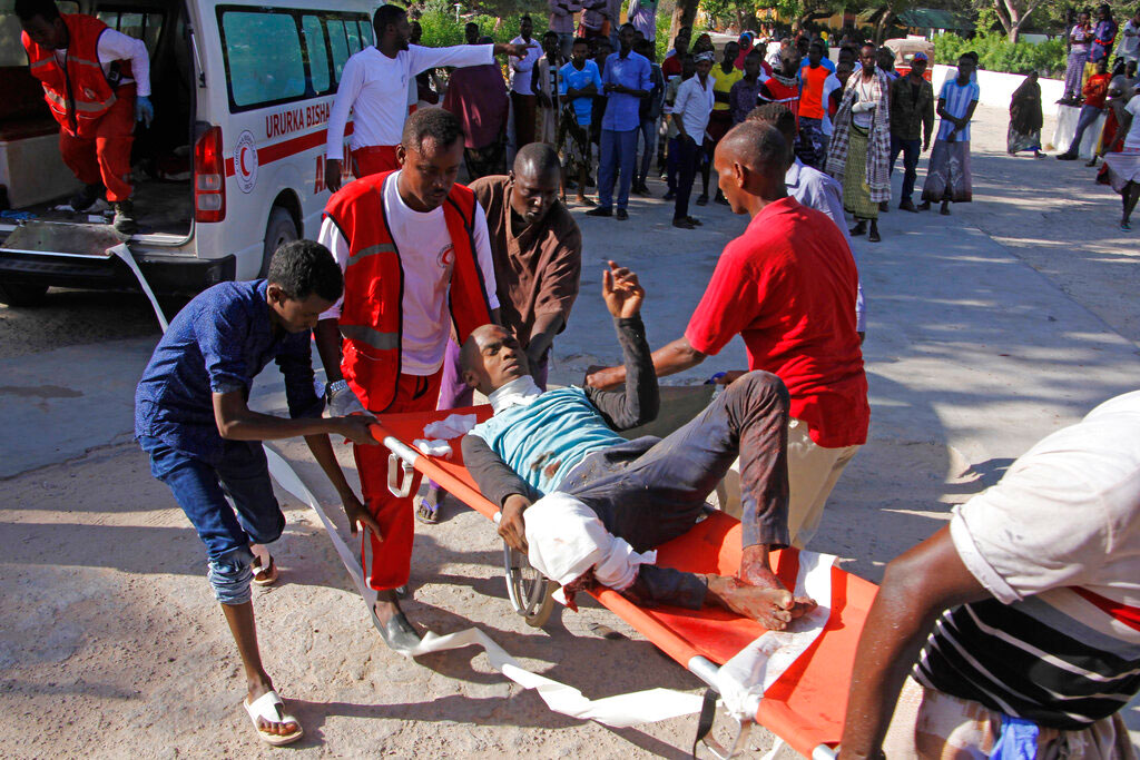Medical personnel carry a civilian who was wounded in suicide car bomb attack at a check point in Mogadishu on Saturday.