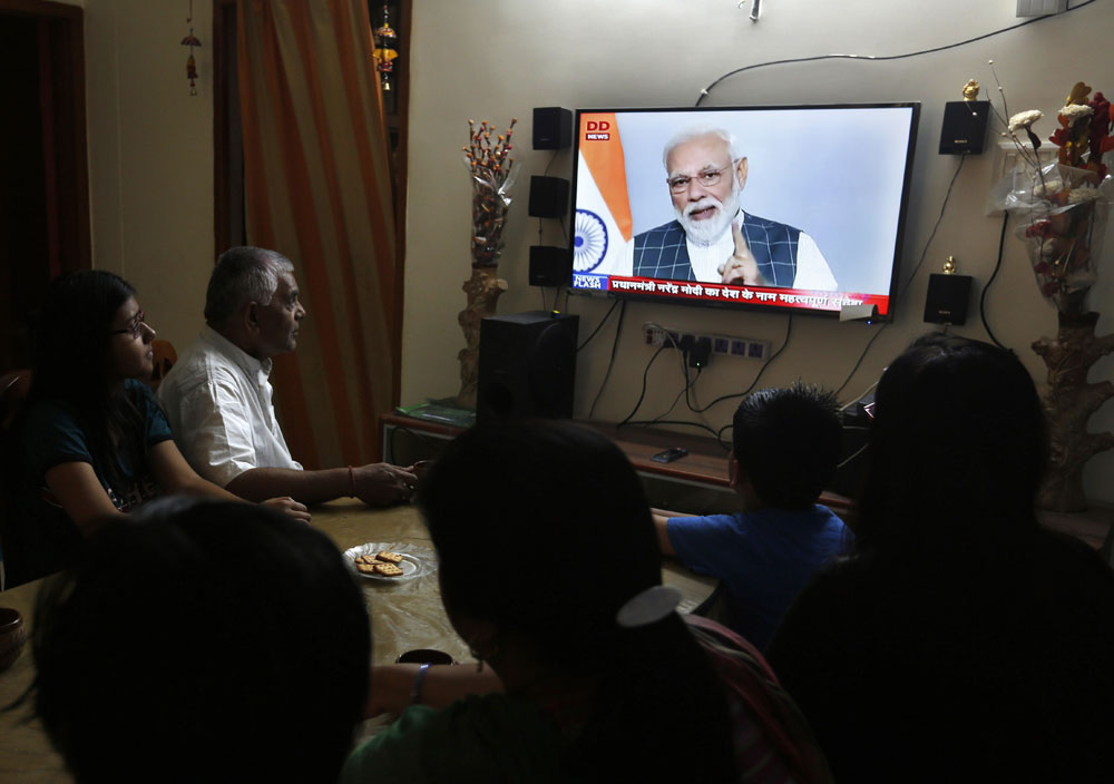 A family watches prime minister Narendra Modi addressing the nation on the success of Mission Shakti, in Prayagraj, Uttar Pradesh, on Wednesday, March 27, 2019.