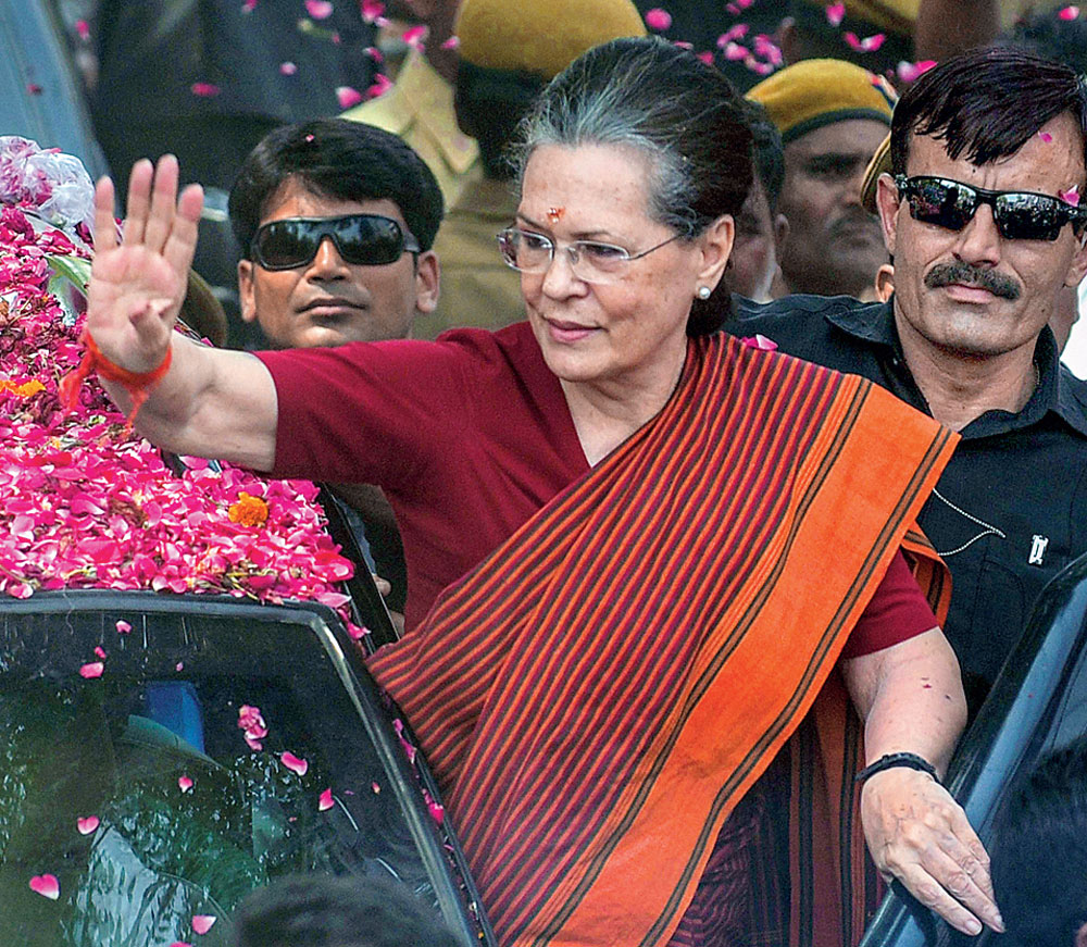 Sonia Gandhi at a roadshow in Rae Bareli before filing her nomination papers on Thursday