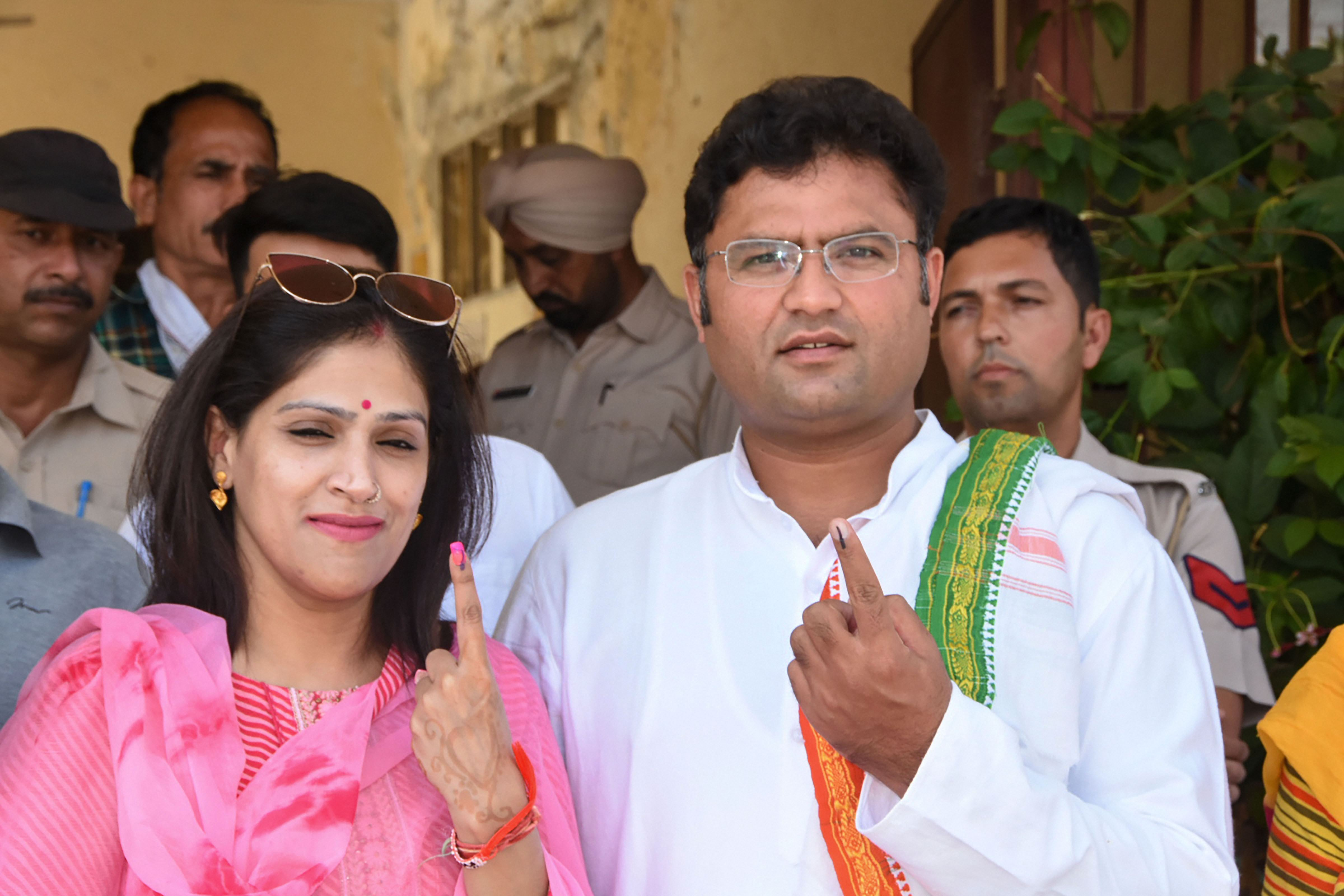 Former Haryana Congress president Ashok Tanwar and his wife Avantika Maken show their inked finger after casting their votes during the Haryana Assembly elections, in Sirsa, Monday, October 21, 2019.