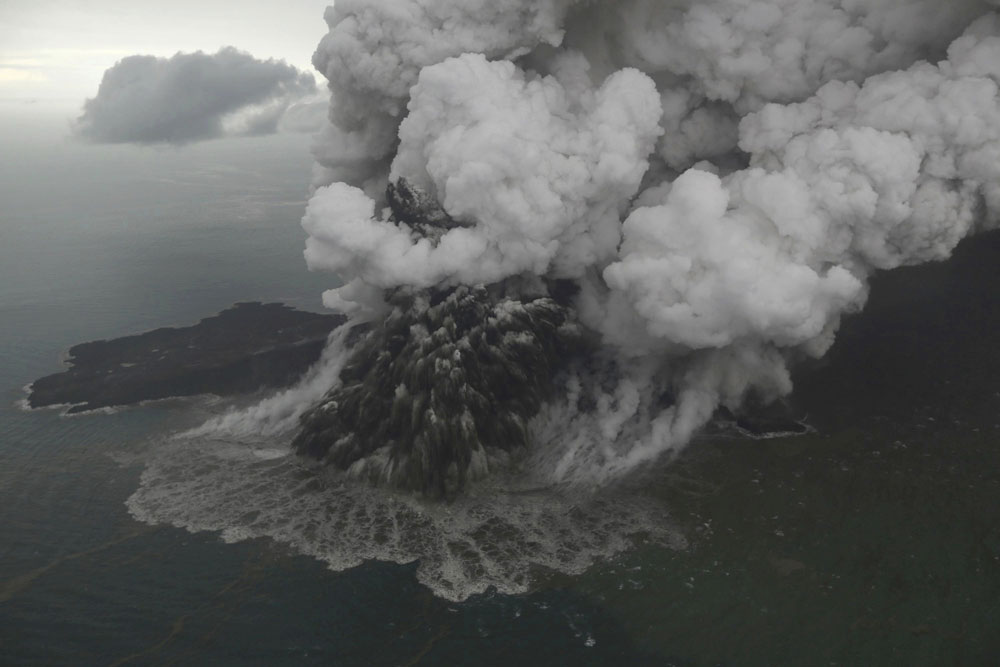 This aerial shot taken on Sunday, December 23, 2018 shows Mount Anak Krakatau as it erupts on Java Strait, Indonesia