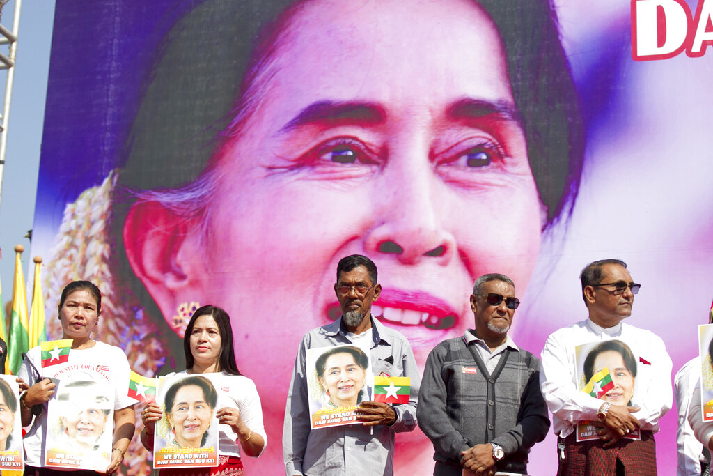 Members of Myanmar Muslims community hold portraits of Myanmar leader Aung San Suu Kyi to pray as they gather in front of City Hall in Yangon, Myanmar.
