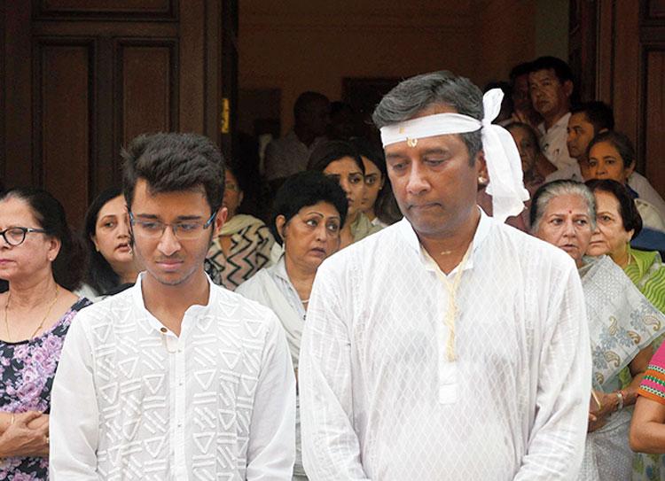 Son Aditya (right) among mourners in Calcutta on Saturday
