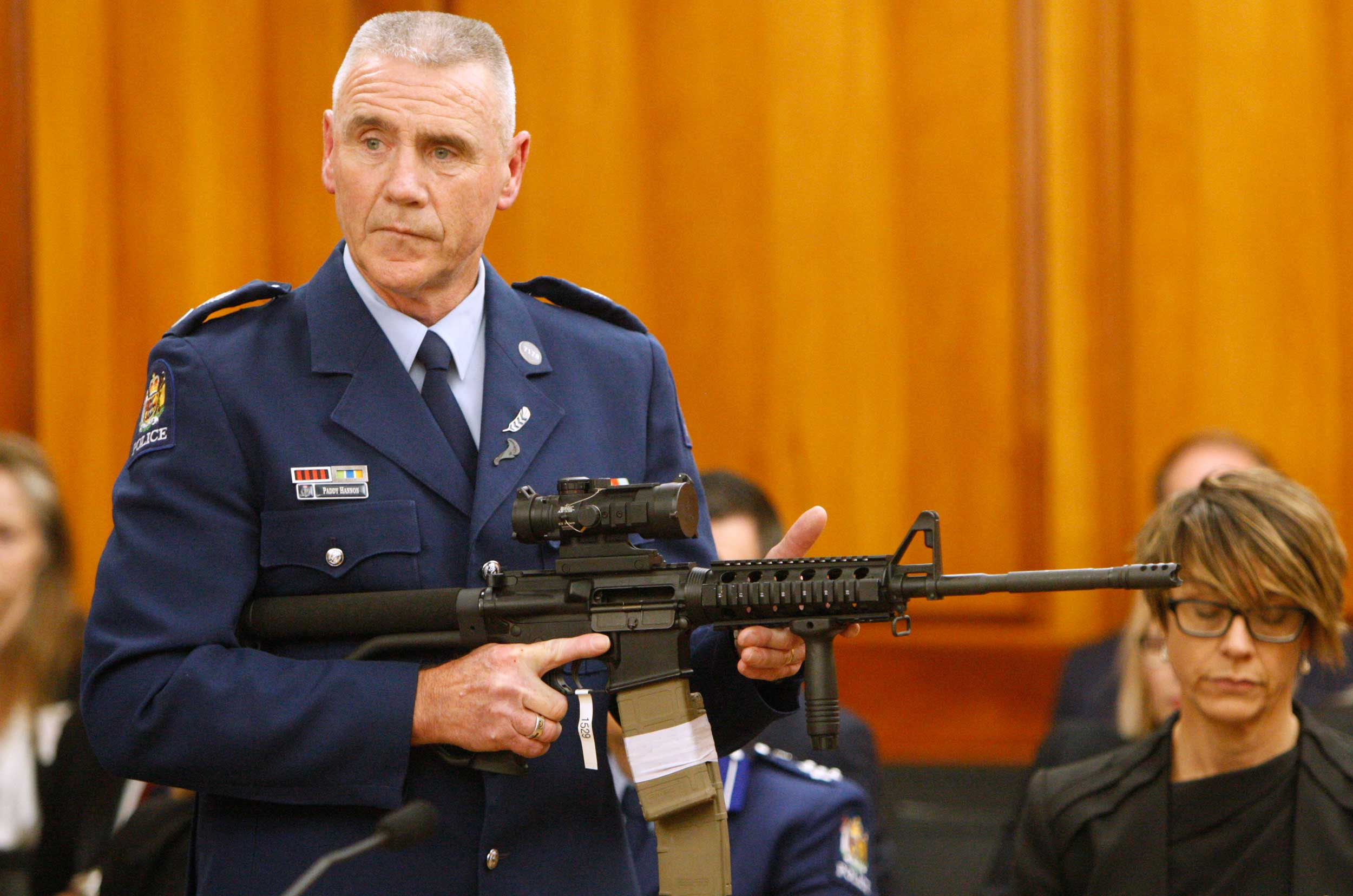 Police senior Sgt. Paddy Hannan shows New Zealand lawmakers an AR-15 style rifle, similar to one of the weapons a gunman used to slaughter 50 people at two mosques, in Wellington, on April 2, 2019.
