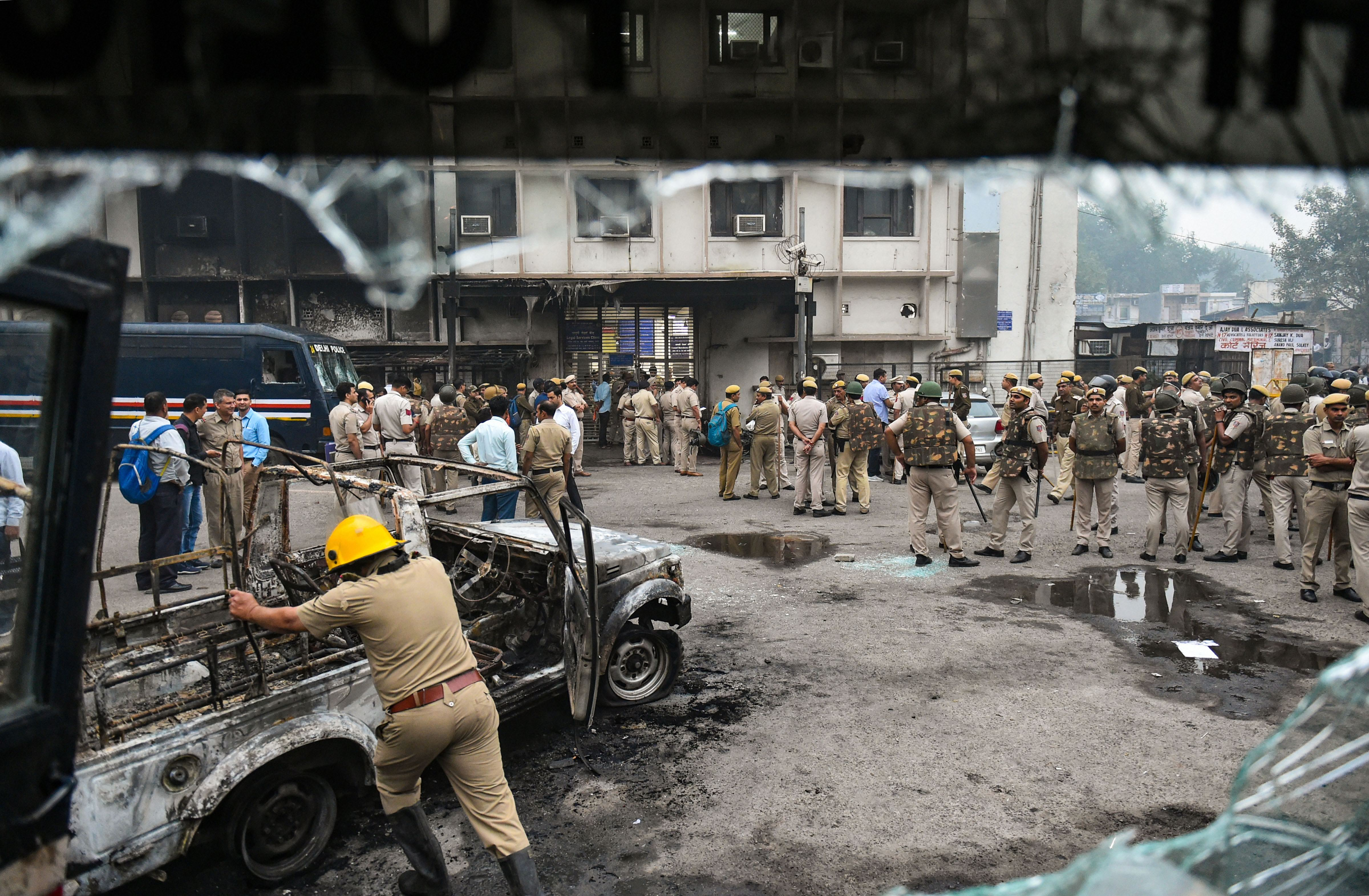 A view of a police vehicle after it was burnt down during clashes between lawyers and police personnel at Tis Hazari court complex in New Delhi, Saturday, November 2, 2019.