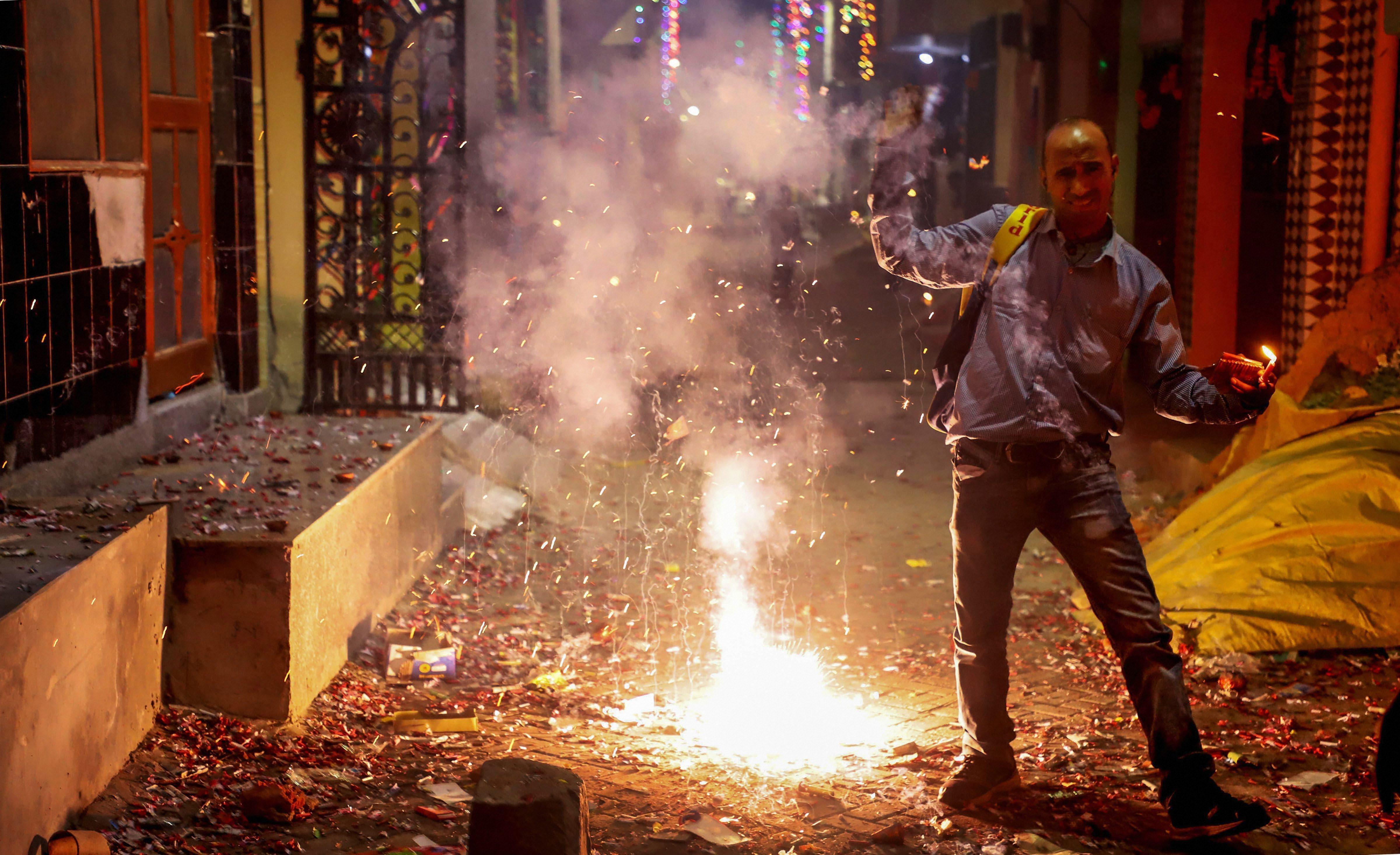 Smoke rises as people burn firecrackers to celebrate Diwali in Gurgaon on Wednesday, November 7.