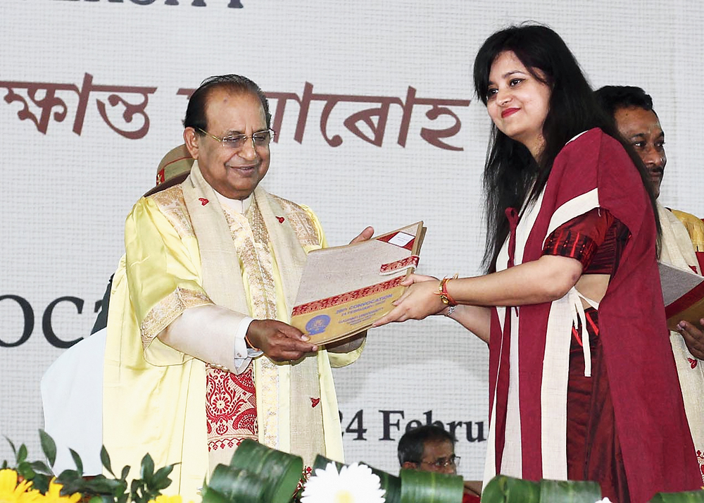 Assam governor Jagdish Mukhi hands over a degree to a student on Monday