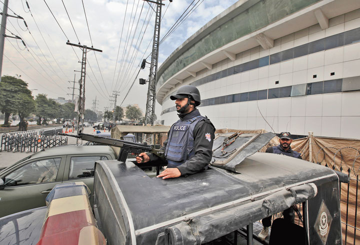 A police commando stands alert outside the Pindi Cricket stadium on Monday to ensure security ahead of the first Pakistan-Sri Lanka Test in Rawalpindi. The Test starts on Wednesday.