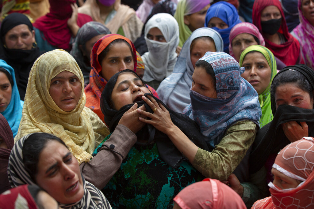 Relatives and neighbours mourn the death of civilian Mehraj-ud-din Shah outside his home in Makhama village, west of Srinagar, on Wednesday, May 13, 2020.