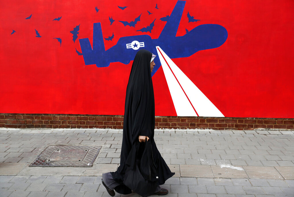 A woman walks past the anti-US mural on the wall of the former US embassy in Tehran on Saturday, November 2, 2019. While it is tough to concur with all of Iran's policies, especially on the domestic front, the way in which it has stood up to the US is admirable