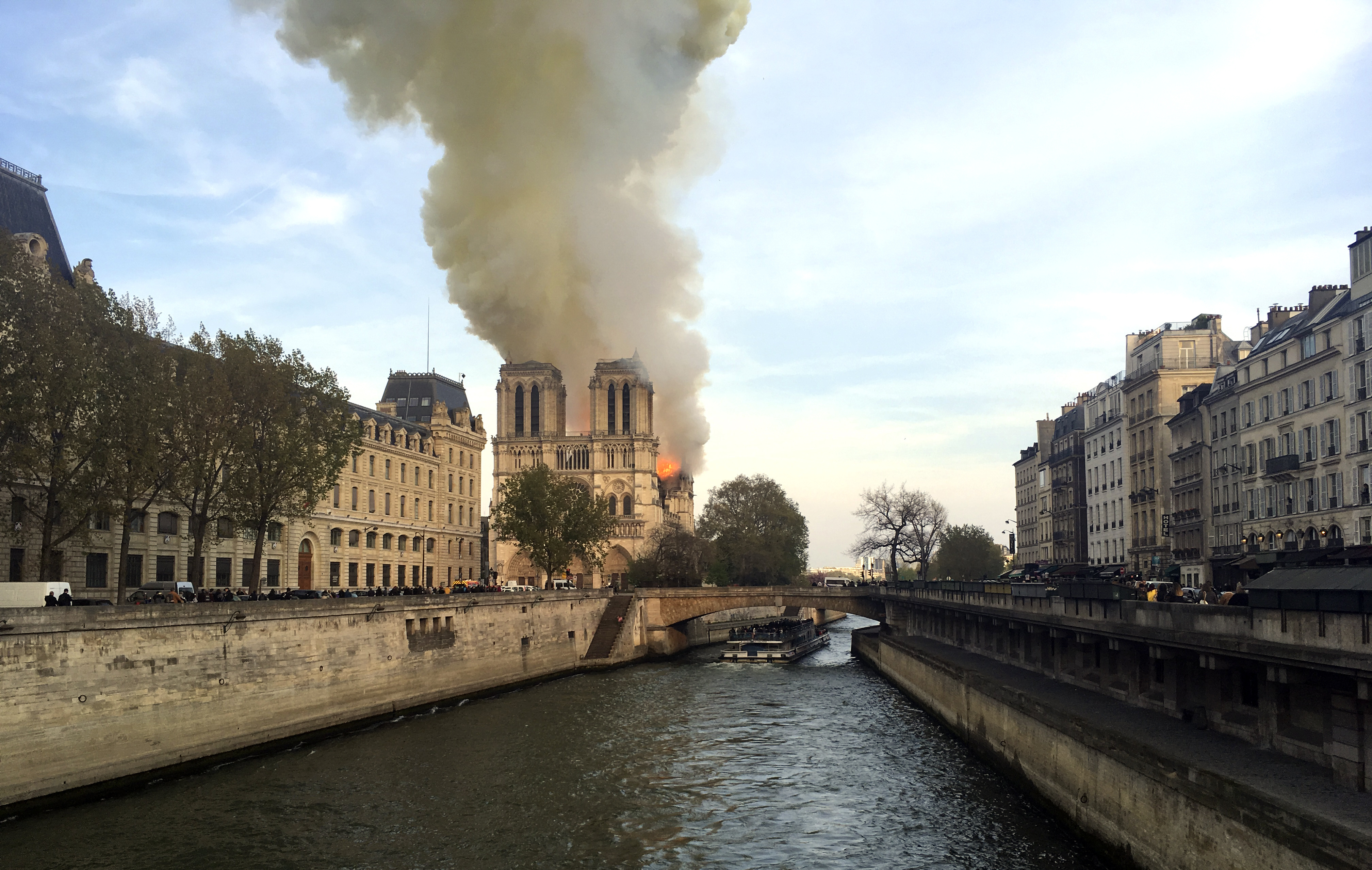 Fire torches top of Notre Dame Cathedral in Paris