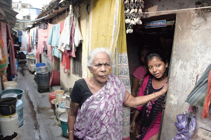 Durga Mondal, Mashi to Abhijit Vinayak Banerjee, with her granddaughter Ankita at their Garcha home on Tuesday
