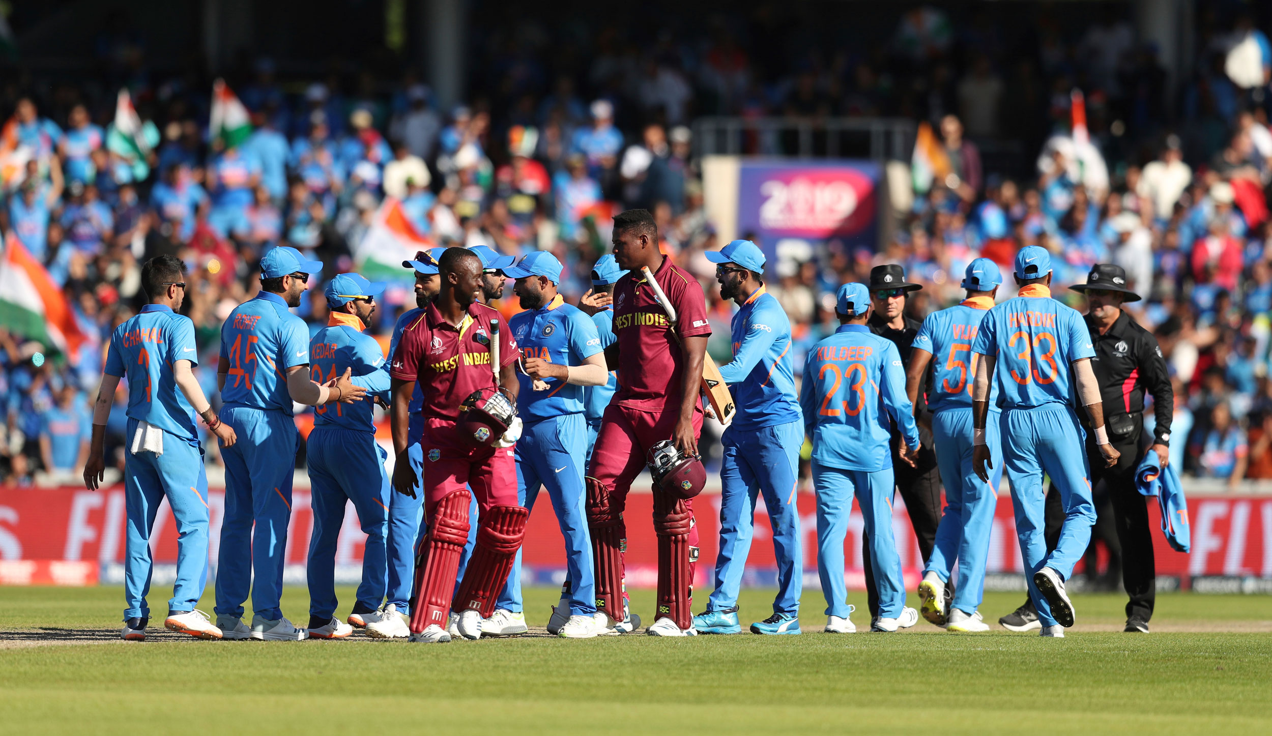 Indian and West Indian cricketers converge after their ICC Cricket World Cup match at Old Trafford in Manchester, England, on June 27, 2019.