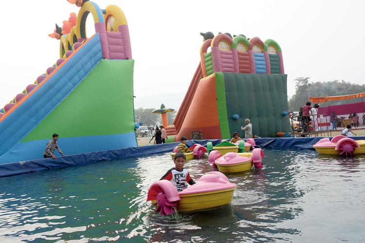 Kids enjoy water rides  at Dimna Lake on Wednesday.