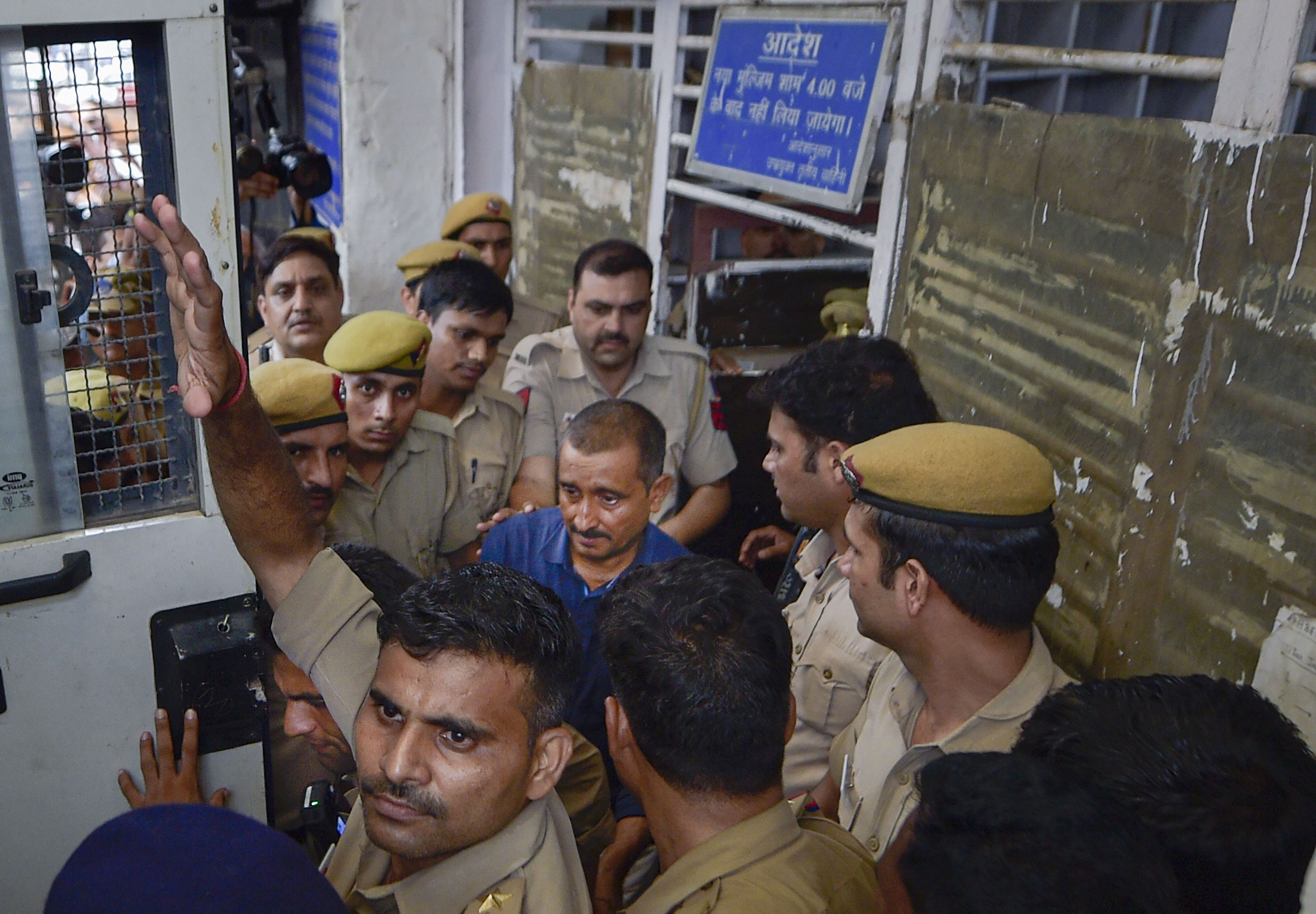 In this file photo dated August 5, 2019, expelled BJP MLA Kuldeep Singh Sengar is taken to Tihar jail after being produced before Tis Hazari court, in New Delhi.