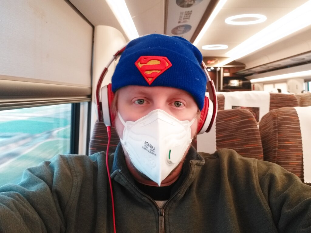 """American citizen James Dickey sits on a train on his way back to his home in Changsha, China. Dickey, a kindergarten teacher in the central city of Changsha, outside the locked-down area, said he was """"really scared"""" and trying to arrange for his daughter and ex-wife to leave Wuhan"""
