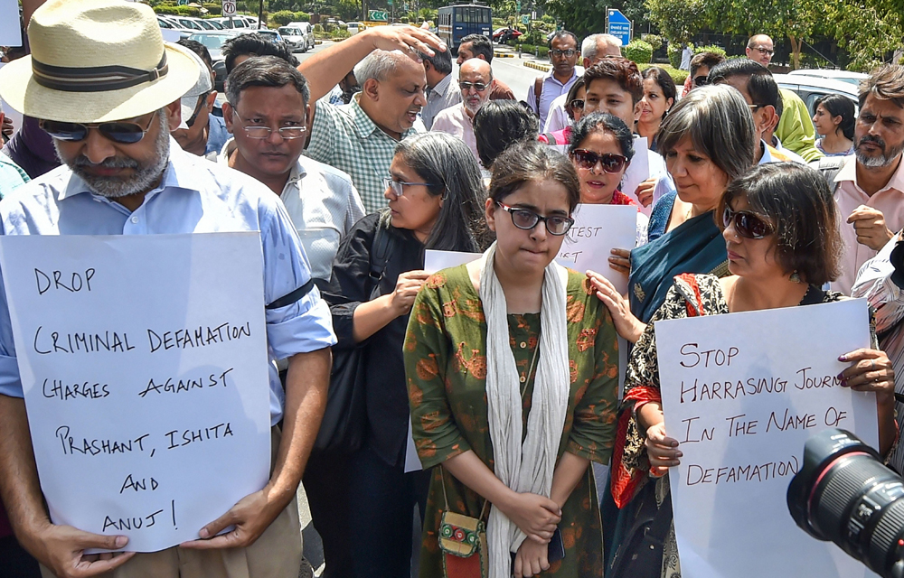 Jagisha Arora, wife of journalist Prashant Kanojia stages a protest against Kanojias arrest, at Press Club in New Delhi, Monday, June 10, 2019. .