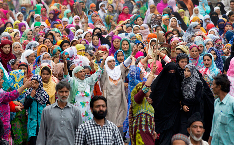 In this Friday, August 9, 2019, photo, Kashmiri women shout slogans during a protest march in Srinagar.