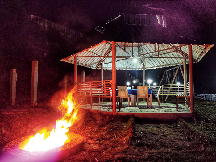 Ask for your dinner to be served at this outdoor area, while you warm yourself up around the bonfire