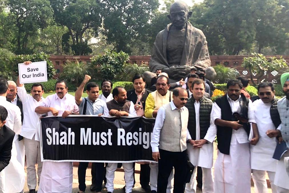Congress leaders Rahul Gandhi, Adhir Ranjan Choudhary, Shashi Tharoor and others held placards demanding answers on the Delhi riots and the resignation of home minister Amit Shah.