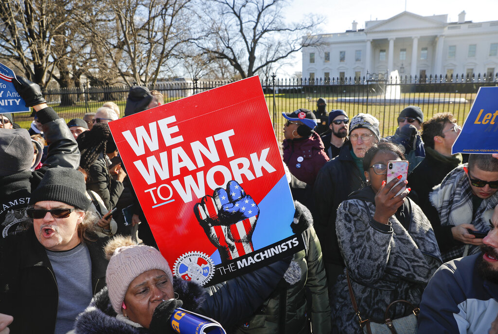 Union members and other federal employees stop in front of the White House during a rally to call for an end to the partial government shutdown on Thursday.