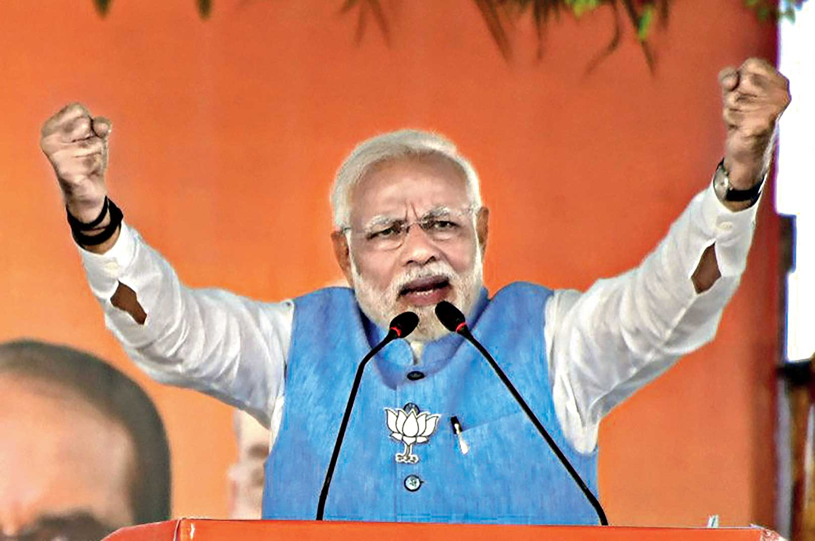 Narendra Modi addresses a public meeting in Vidisha on Sunday ahead of the Madhya Pradesh Assembly elections. At the rally, the Prime Minister attacked the Congress for dragging his parents' name into the campaign.