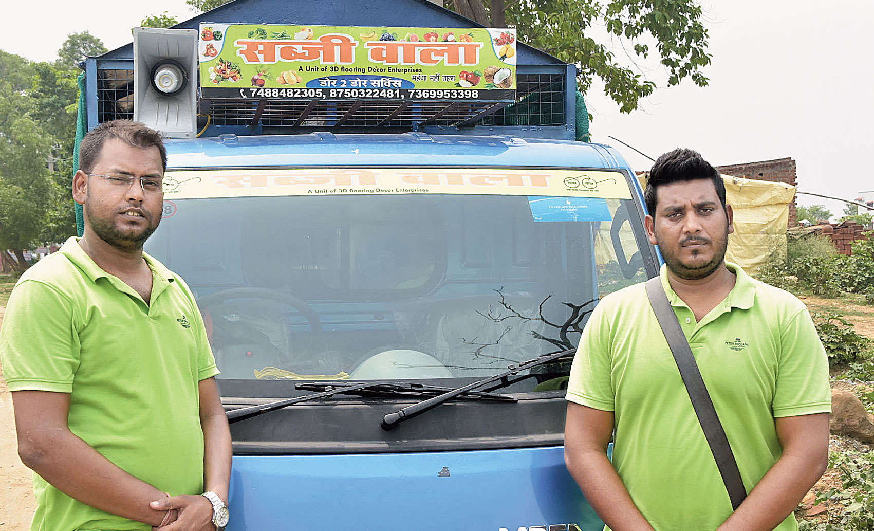 Sudama (right) and Ravi with their mobile vegetable van in Dhanbad on Sunday.