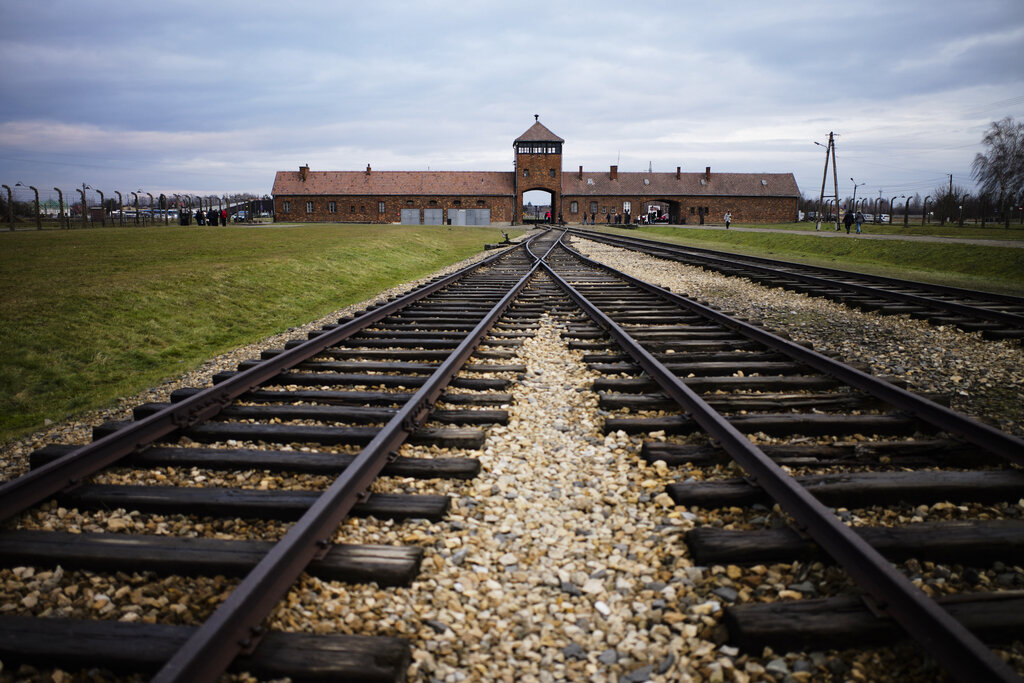 In this Deccember 7, 2019, photo, railway tracks from where where hundreds of thousands of people were directed to the gas chambers directed to the gas chambers to be murdered, inside the former Nazi death camp of Auschwitz Birkenau or Auschwitz II, in Oswiecim, Poland. World leaders will gather twice to mark the 75th anniversary of the liberation of the Auschwitz-Birkenau concentration camp _ once on Thursday, Jan. 23, 2020, in Jerusalem and again on Jan. 27 at the Auschwitz site in southern Poland. The fact that there will be two competing ceremonies reflects how politically charged World War II remains for nationalist governments in Russia and Poland.