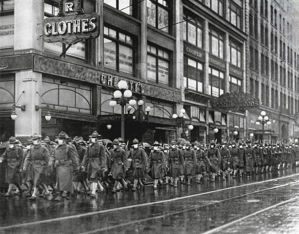 US soldiers in Seattle wear masks to prevent influenza in December 1918. The soldiers were on their way to France during the influenza pandemic