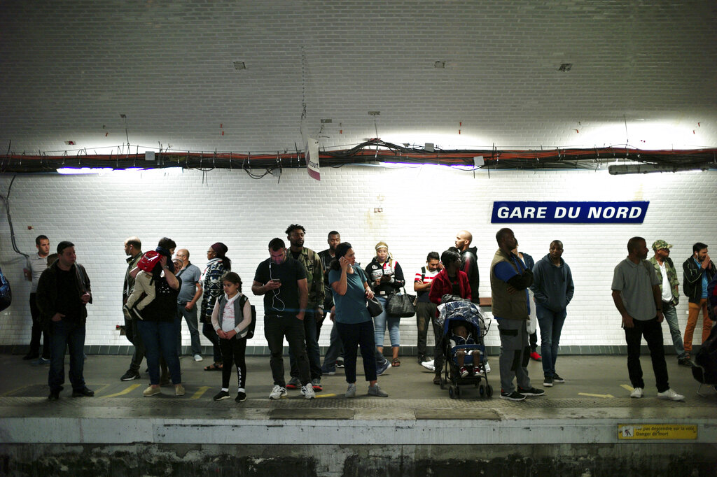 Commuters wait to board a train, in Gare du Nord railway station, in Paris, on Friday, Sept. 13, 2019.