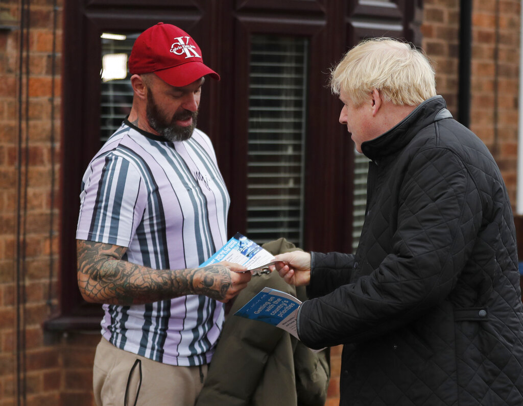 Britain's Prime Minister Boris Johnson, right, accompanies the Conservative party candidate for the Mansfield constituency Ben Bradley canvasing during a General Election campaign trail stop in Mansfield, England, on Saturday, November 16, 2019.Britain goes to the polls on December 12.