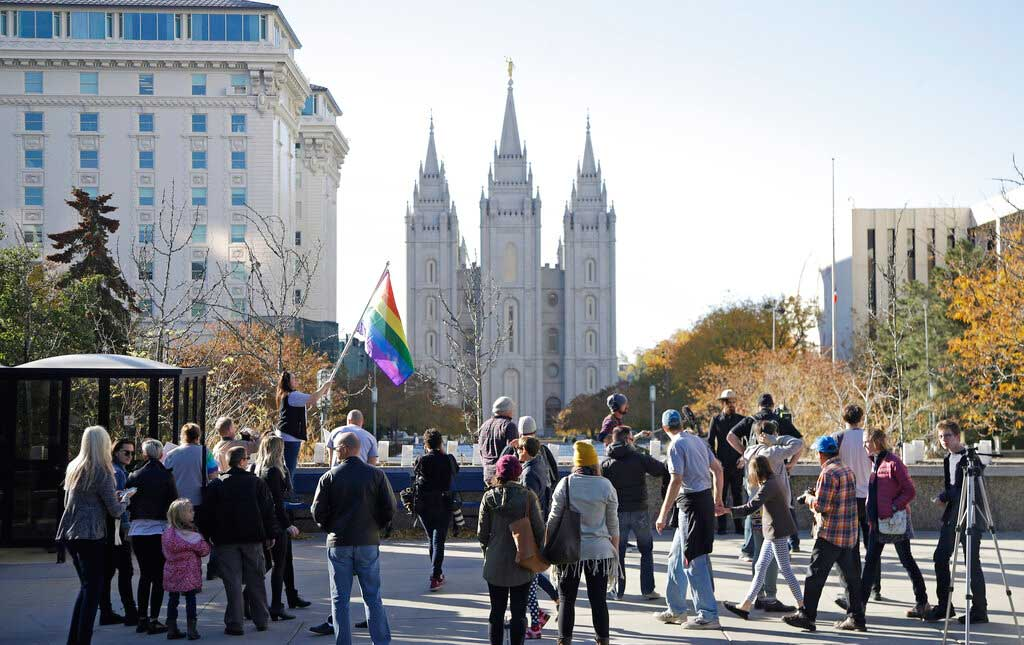 People walk past the Salt Lake Temple after mailing resignation letters during a mass resignation from the Church of Jesus Christ of Latter-day Saints in Salt Lake City on November 15, 2015.