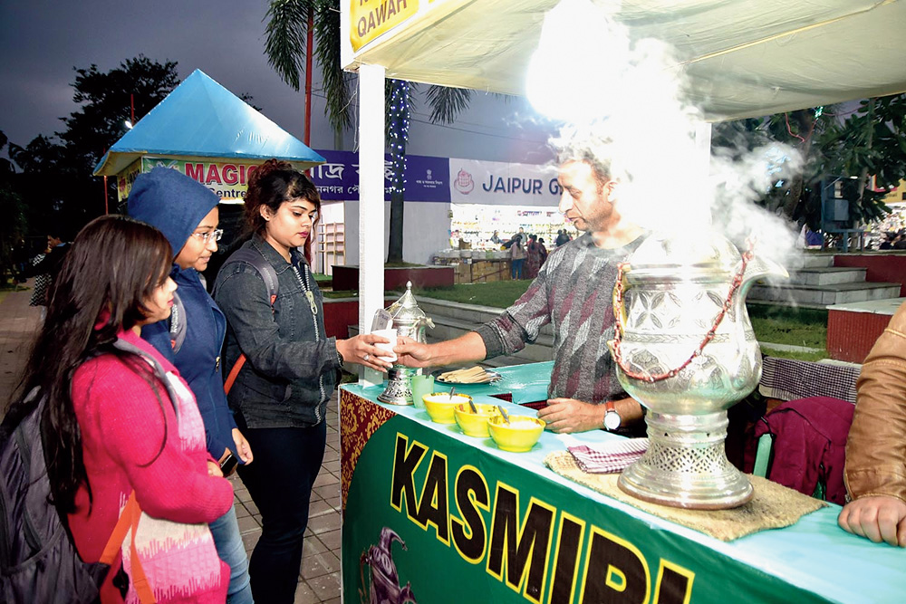Visitors try Kashmiri tea Kahawa.