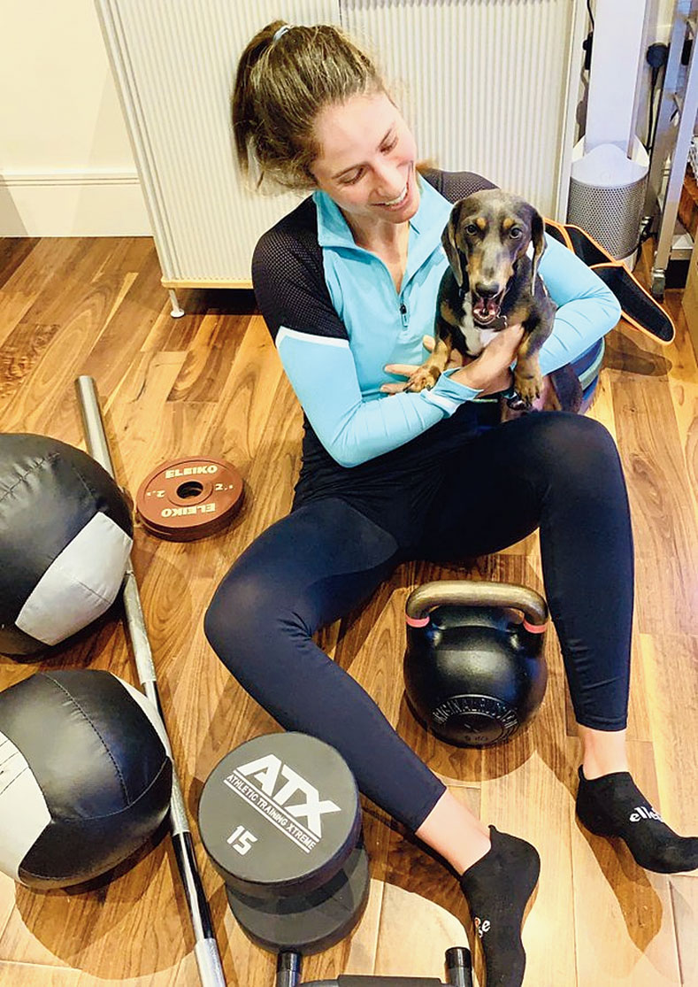 British tennis player Johanna Konta plays with her dog as she takes a break from a workout session at home